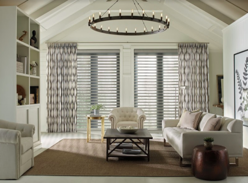 Draperies can be paired with almost any window covering to create an environment custom fitted to your taste.