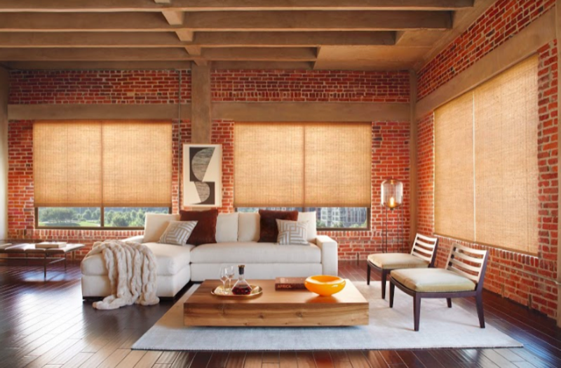 Woven woods are made up of different materials such as woods, reeds, bamboos, and grasses. They use natural light to transform the room.