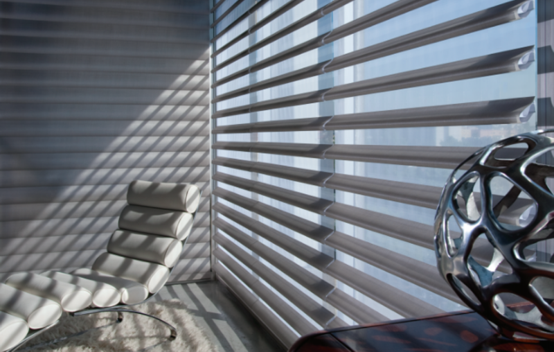 "Offered exclusively by Hunter-Douglas, the Pirouette, has horizontal fabric vanes attached to a single sheer backing. The revolutionary ""Invisi-Lift"" system allows the fabric vanes to appear to be floating."